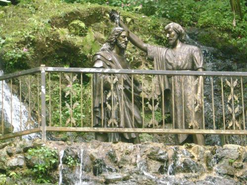 John the Baptist and Jesus - This is a picture of a statue of John the Baptist baptising Jesue. This statue is in Maicaw, Puerto Rico.