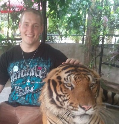 Dan and the Tiger - My nephew Dan has shore leave from the Navy in Thailand last weekend. He was able to meet a tiger at a tiger zoo! I would be scared to get that close to a tiger but Dan had the privelage to!