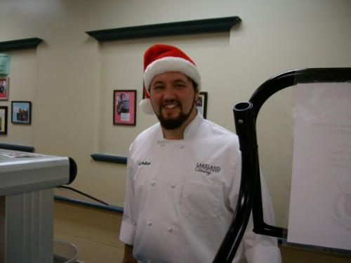 Jeff,the little brother - Jeff was doing a holiday cooking demotration last December and that is why he has a Santa hat on!