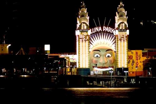 amusement park - an amusement park at night.