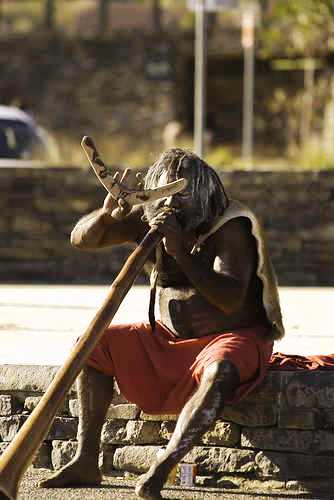 native - a native tribal man resting for he got lost in the streets.