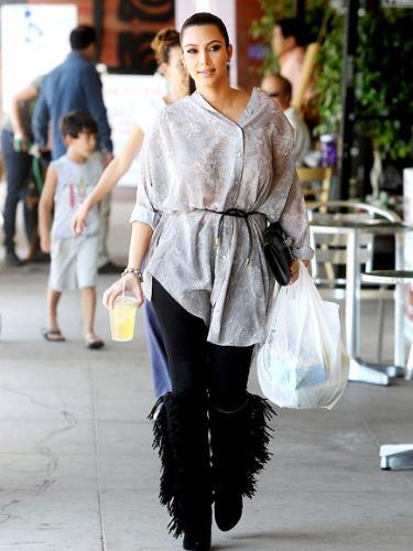 Kim kardashian - I love the fringed boos! Kim dresses better then her sisters!