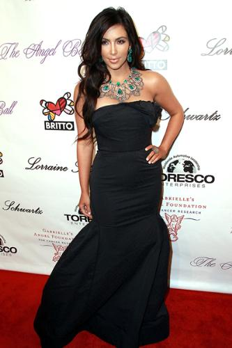 Kim Kardashian - She is beautiful and probaly has to work hard at it to be the way she looks!