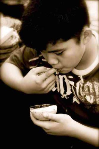 food - a boy eating.