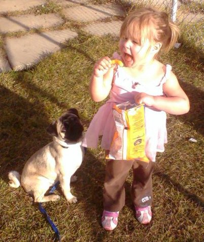 My Daughter and pug Mr Man - He is just looking right up at the cheezie just wishing that there was a way that he could possibly jump that high ... lol!