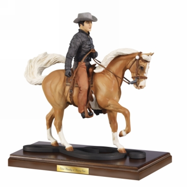 Elvis on his favorite horse - To celebrate Elvis's love for horses,Breyer has a model of Elvis riding his Palomino Rising Star.