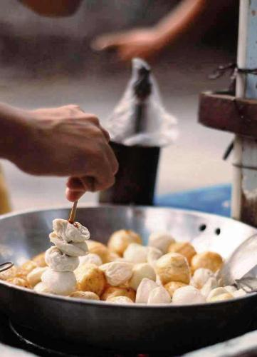 balls - flavored flour balls being cooked as street food in the philippines