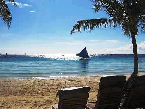 beach - a beach with boats.
