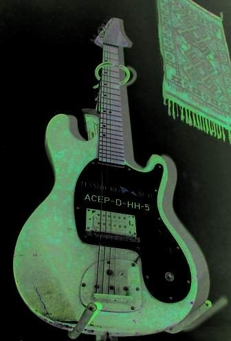 Electric guitars in the green light - Photo Gallery