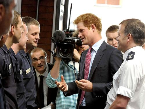 Prince Harry - Prince Harry talking to some people.