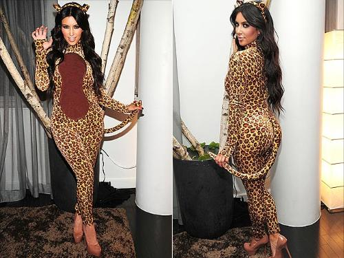 Cat woman - Kim Kardashian dressed as a leopard for Halloween one year.