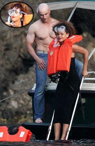 This makes no sense! - Rihanna went snorking off Italy in a dress! Strange!
