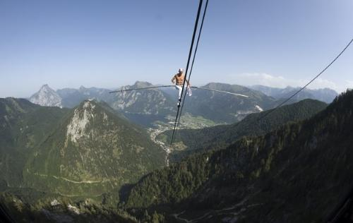 Tight rope walker - Tight rope walker Freddy Nock walking a cable car cable in Germany. He wants to walk on all the cable car cables in Germany and Austria to set a record.