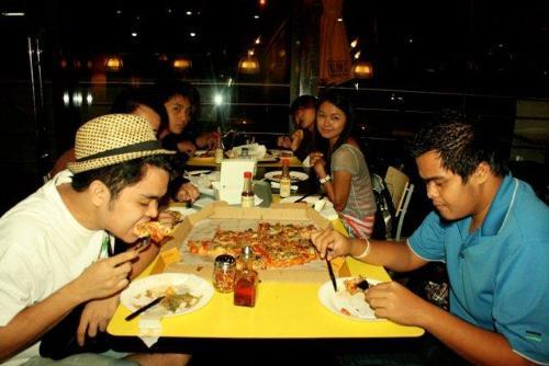 Enjoying Pizza - Pizza Lovers