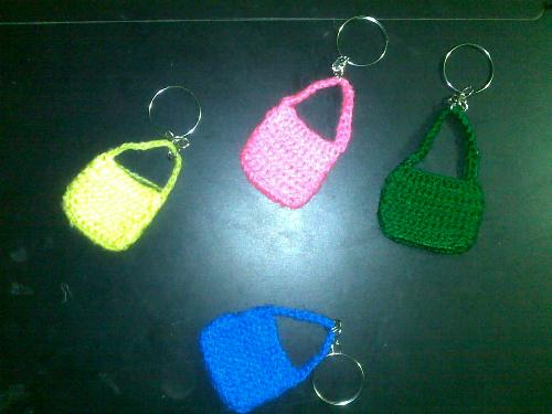 crocheting keychain - simple crochet work...actually I wanted to make a big bag but i was too lazy so I made smaller bag as key chain. Was too lazy to changing color but I will add accesories later