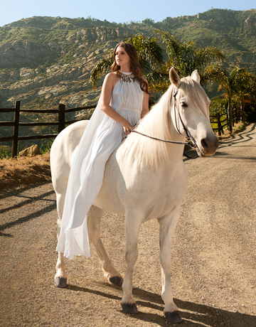 Katherine Schwarzenegger - Here Katherine in on a horse for a photo shoot for Harper's Bizarre.