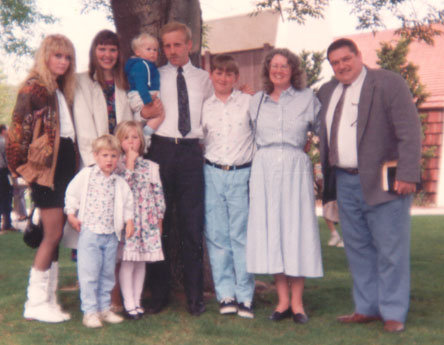 Family Picture on Jason's Baptism Day, April, 1991 - Sarah, on far left, is now 17, and has left us to put herself back into the system. Jason, who succeeded in his fight to stay with us, is now 13, and is third from the right. Kosta and I are next to him on the right, and everyone else are extended birth family of Sarah and Jason who came to see him baptised. In four months, Jason will die in an accident while riding a jet ski.