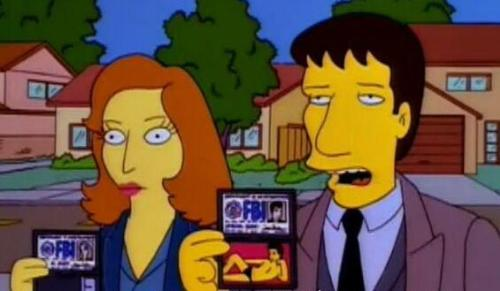 The Simpsons - The X-Files - Gillian Anderson and David Duchovny playing their characters from The X-Files, Dana Scully and Fox Mulder on 'The Springfield Files'.