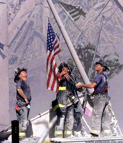 Firemen raising flag on patriots day - Firemen raising flag in memory of all those lost on 9/11.