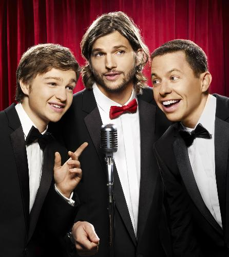New two and a half men - A photo of Ashton Kutcher replacing one of the lead stars, Charlie Sheen, of the TV series Two and a half Men, together with the other leads.