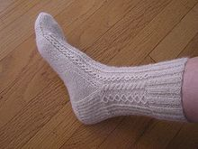 White sock - A hand knitted lace sock. Looks very comfortable!