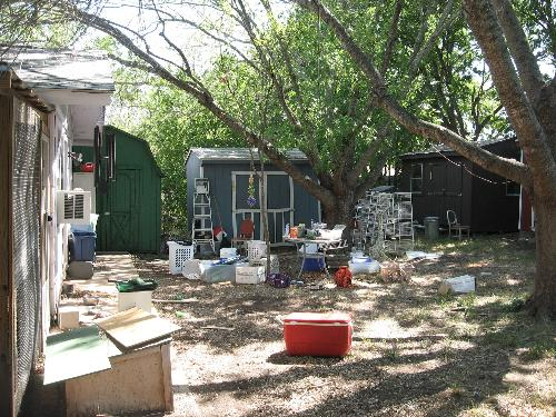 The green blue and brown sheds - and some of the assorted junk from spring
