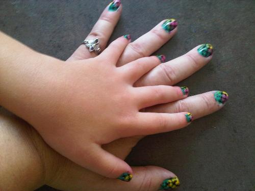 Mother and Daughter nail art - two hands with pretty nail art on the fingers