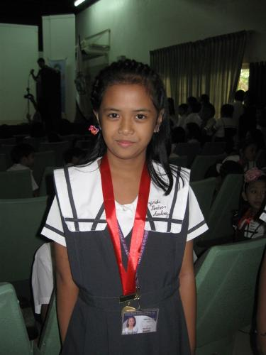 My daughter, Alyanna - Being on overall top 4 in her 3rd grade last year of 2010. I'm happy that I have Alyanna as a daughter. She's my eldest and still a baby to me...