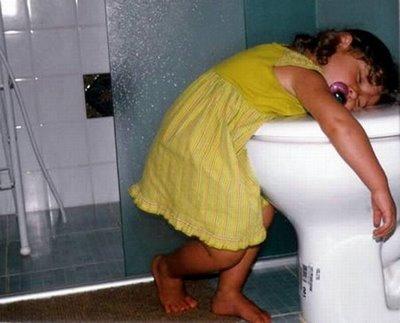Sleeping in Toilet - A small baby sleeping in toilet