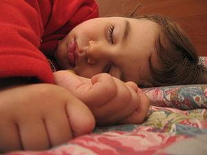 child sleeping nice - child sleeps and dreaming something
