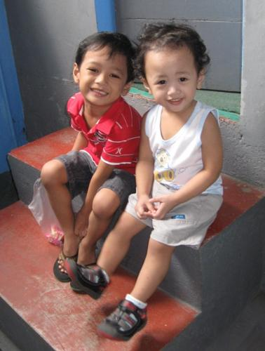 My 2 fighting yet loving kids! - Loves each other yet fighting with their toys *sigh!