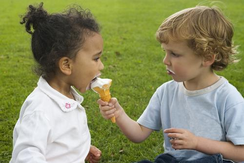 File sharing  - Someone shares his ice cream with a friend.