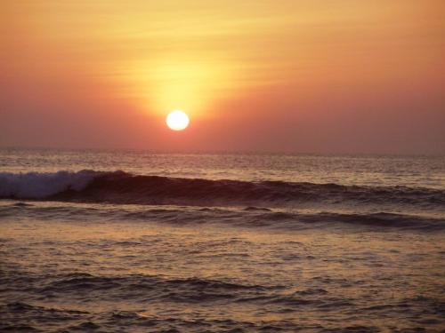 sunset at the beach - Taken at the shore of San Fernando La union while on vacation.