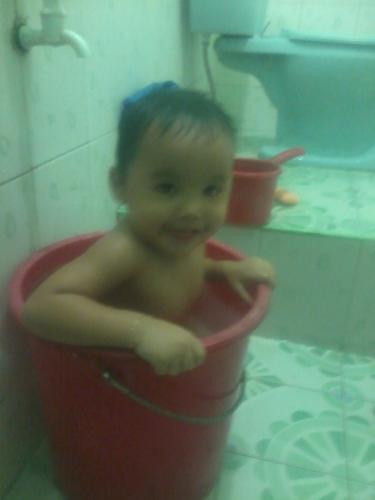 my kid - my lil kid inside the pail ahahaha