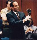 Oj Simpson - Oj Simpson tring on the glove at his trial.