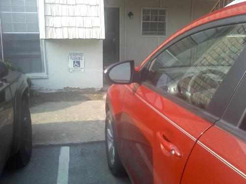 """handicapp sticker - this is a car parked in the handicap parking spot outside my apartment. Says he didn't """"see"""" it."""