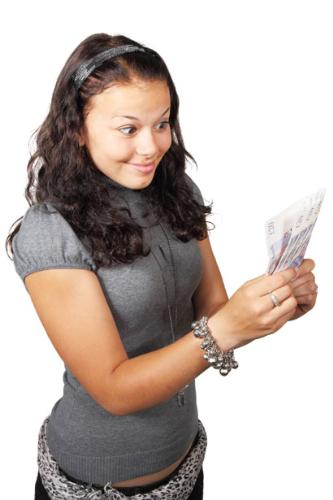 Woman looking at money - woman admiring her money