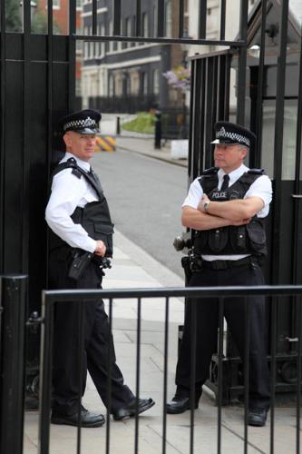 Police - the police guarding a gate