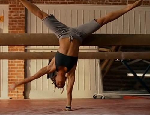 """Missy Peregrym in """"Stick It"""" - Missy Peregrym doing a handstand in practice in the movie """"Stick It."""""""