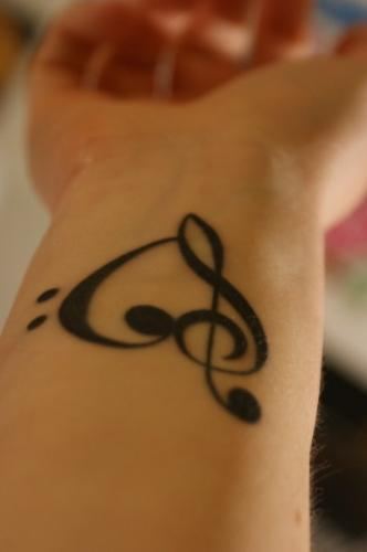 Musical Heart - This is a tattoo of a heart on wrist, where the heart is drawn in such a way as to have a musical note on one side of it.