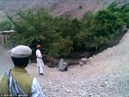Afghan Woman Gunned due to Taliban Love Triangle - The woman sitting at the edge of the cliff was killed due to two Taliban men who had a relationship with the woman. They instead opted to accuse her of adultery to 'save face'. 