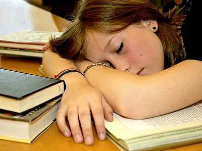 sleeping  - hard working students are sleep-deprived.