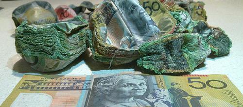 Burnt Money - Burnt Australian dollars, picture from this full article: http://news.yahoo.com/blogs/sideshow/man-hides-cash-over-cash-gets-baked-accident-122700396.html