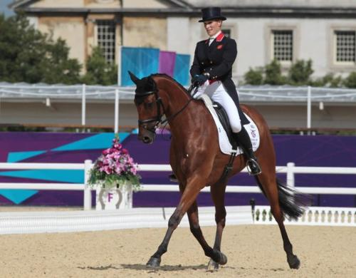 at the trot - Zara Phillips of Great britian on her horse High Kingdom performing at a trot in the dressage faze of three day eventing.
