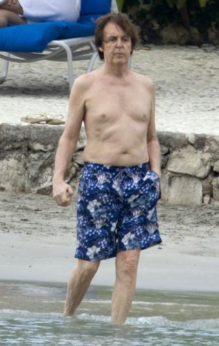 Sir Paul - Pauk McCarthney going for a swim. He looks a little pasty but other then that he looks good for 70!