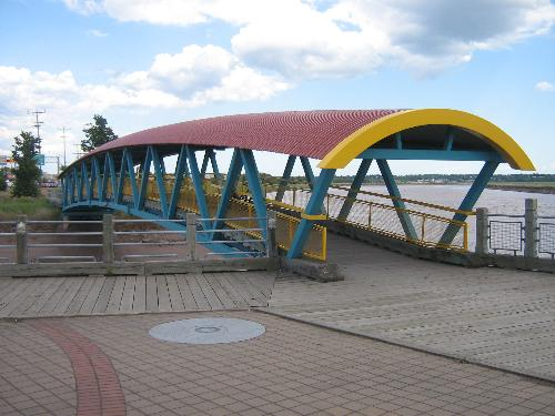 Moncton pedestrian bridge. - I always thought this pedestrian bridge was picturesque. It is along my route home from work. The boardwalk leading to it from the one side can be really slick in wet weather and the loose gravel on the other side can catch a bike rider a little unaware.