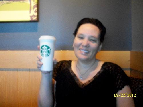 Me and my Starbucks - Here is me with my Starbucks drink.