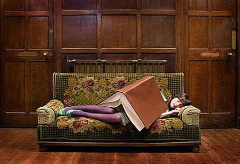 A girl sleeping while reading book - Study books is a good way for sleeps