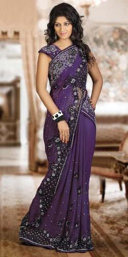 A women wear party wear sari - A women looking good on sari