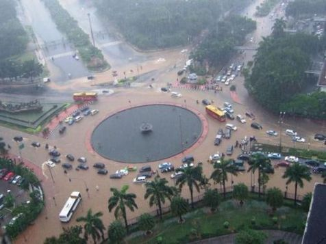 flooded city - this picture is my capital jakarta when it was flooded. you can see many cars flooded to